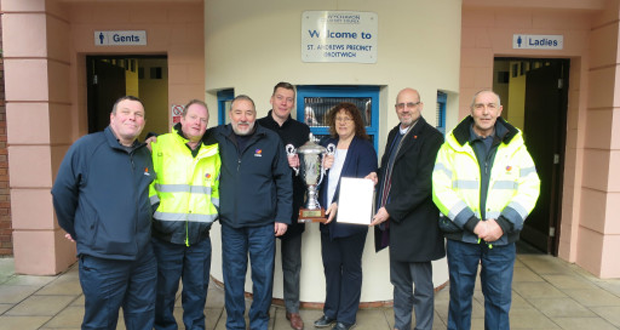 David Abbott, Eric Johnson, Jan Totney, Ross Totney, Councillor Emma Stokes, Phillip Childs (Wychavon District Council) and Gerald Roberts with the trophy outside the award-winning toilet